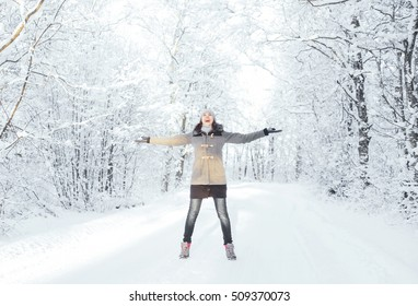 Happy girl walking in beautiful winter forest. Christmas concept.