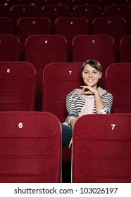 Happy girl is watching a comedy