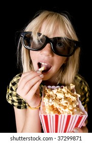 Happy Girl Wearing New Style 3-D Glasses in a Movie Theater