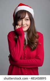 Happy girl wearing santa hat, looking up to copy space, Christmas concepts, Christmas santa hat concepts.
