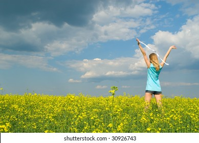 The happy girl in a yellow field