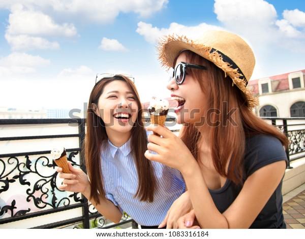 happy girls enjoy ice cream and summer vacations