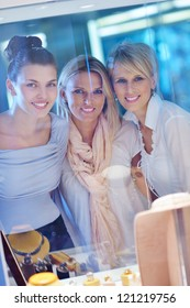 happy girls group  have fun while shopping in jewelry store