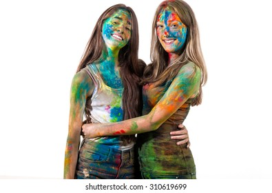 Happy girls in holi paint
