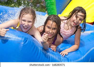 happy girls in inflatable pool