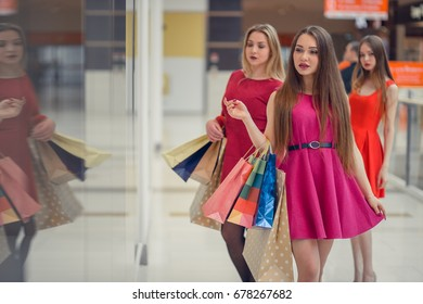 Happy girls out shopping at the mall