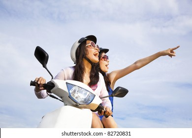 happy girls riding scooter enjoy summer vacation