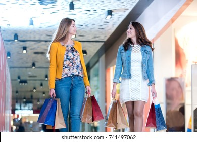 happy girls shopping at mall. bags, shopping, smile, concept