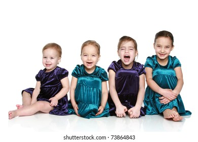 Happy girls sits on a white background