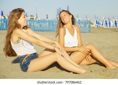 Happy girls in summer on beach
