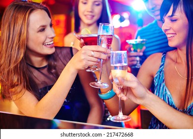 Happy girls toasting with champagne at party