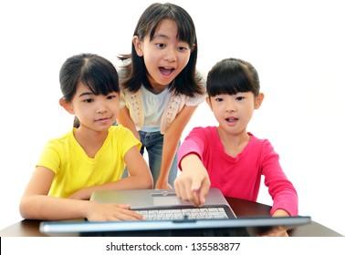 Happy girls using a laptop