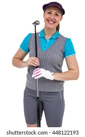 Happy golf player posing with golf club on white background