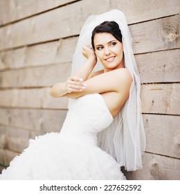 Happy gorgeous brunette bride on wedding day.