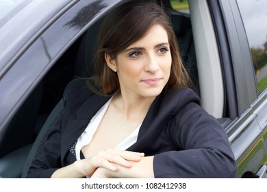Happy gorgeous lady smiling in car