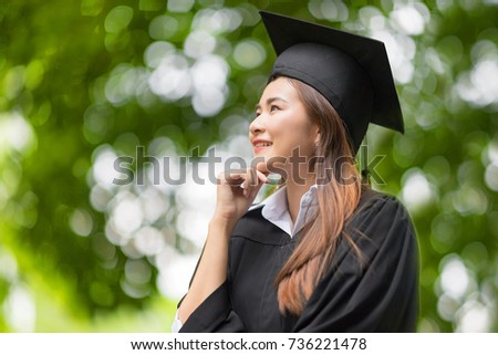 75fe41ffae Happy Graduate. Happy Beautiful woman in graduation gowns holding a  Certificate and a Hat in
