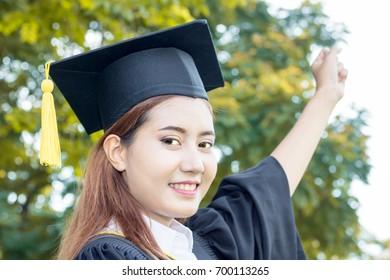 happy graduate in hand with in the garden