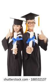happy graduating students with thumb up