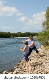 Happy grandfather and grandson fishing.