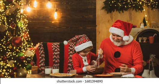 Happy grandfather and son in Santa hat make Christmas cookies. Christmas Celebration holiday. Christmas food and drink