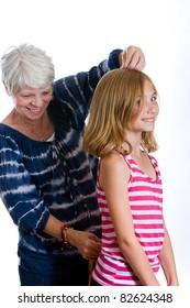 Happy Grandma and Grandchild with a measuring tape.
