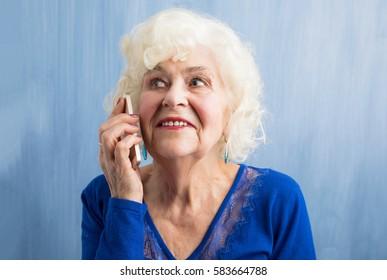 Happy grandma talking on smartphone