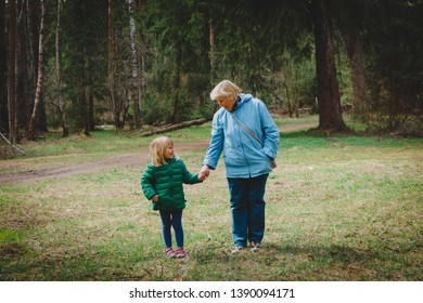 happy grandmother with child walk in nature