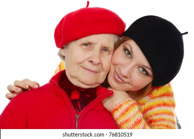 happy grandmother and granddaughter with berets. isolated on white