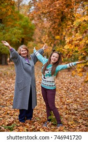 Happy grandmother and granddaughter in the park.