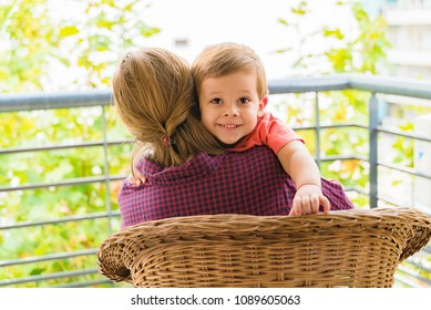 happy grandmother with grandson on the balcony