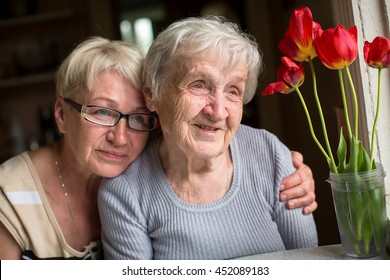 Happy grandmother with her adult daughter.