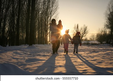 Happy grandmothers enjoying their grand children outside in winter - family portrait.
