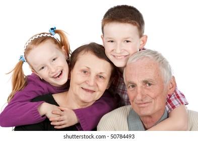 Happy grandparents and grandchildren isolated on white