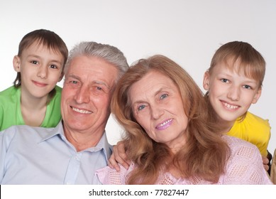 happy grandparents and grandsons on a white