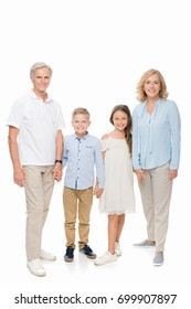 happy grandparents and kids holding hands isolated on white