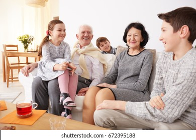 Happy grandparents spending amazing time with their lovely grandkids