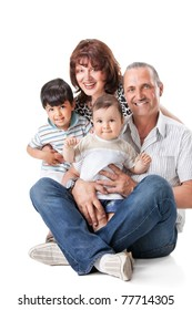 Happy grandparents with two handsome grandsons , isolated on white