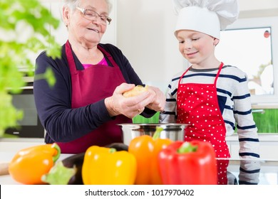 Happy granny cooking together with her grandson