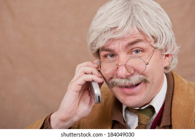 Happy Grey Haired Old Man Talking On The Telephone.