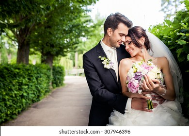 Happy groom and bride outdoor on the wedding day