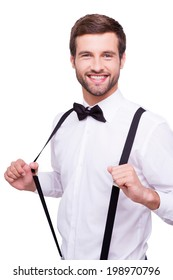 3981a9f698dd Portrait of handsome young man in white shirt and bow tie adjusting his