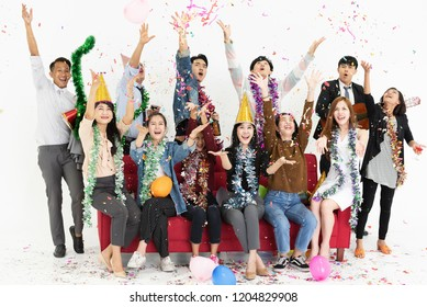 Happy group of Asian business people in new year party on white background.