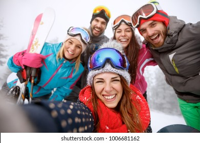 Happy  group of boys and girls together on skiing