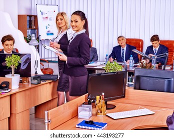 Happy group business people in office. Business woman is printing out.