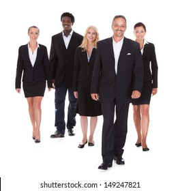 Happy Group Of Business People Standing Over White Background