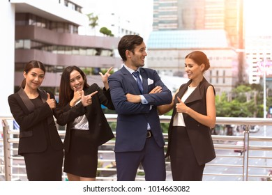 Happy Group of Businesswomen Marketing Team with young Big boss good performance as Coworker and Group of diversity people power tag team,Thumb up for the great boss,Teamwork cheers with Partnership