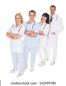 Happy Group Of Doctors Standing Over White Background