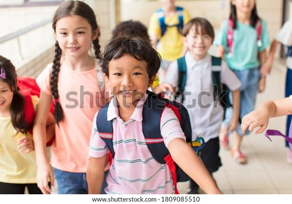 happy Group of elementary school kids running forward