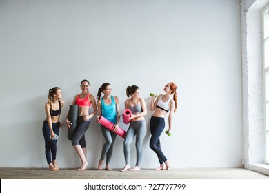 Happy group of fit women at the gym. Fitness, yoga, exercise.