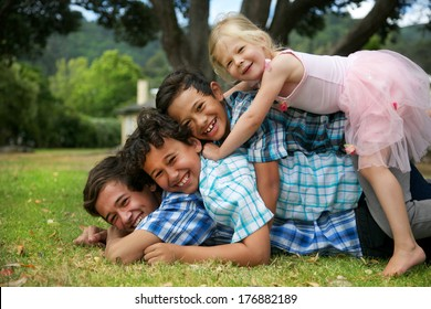 Happy group of four young children.